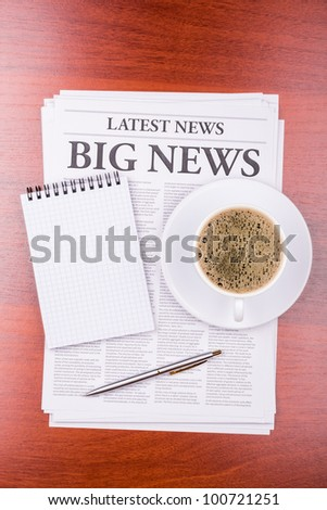 The newspaper LATEST NEWS with the headline BIG NEWS  and coffee - stock photo