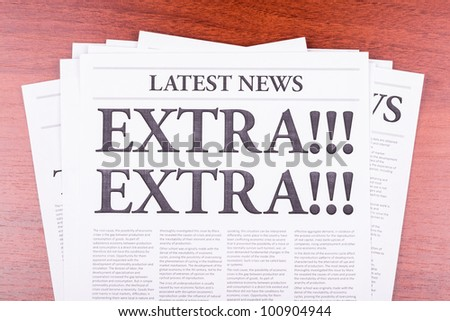 The newspaper LATEST NEWS with the headline EXTRA! EXTRA!