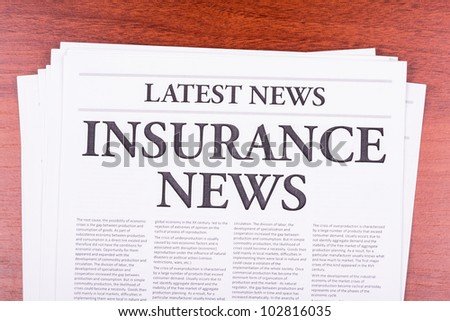 The newspaper LATEST NEWS with the headline INSURANCE NEWS - stock photo