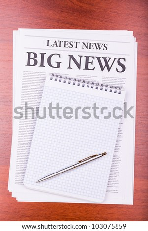 The newspaper LATEST NEWS with the headline INSURANCE NEWS on table - stock photo