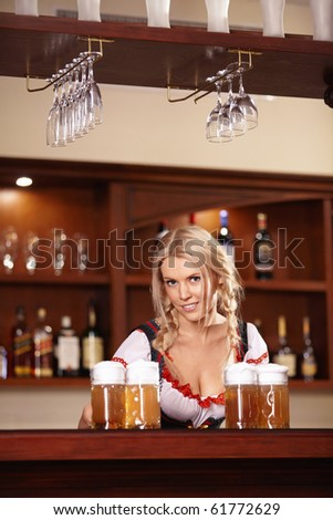 The nice girl behind the bar with beer