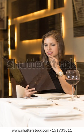 the nice girl chooses what to eat . photo - stock photo