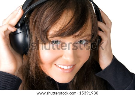 The nice girl listening to music through ear-phones