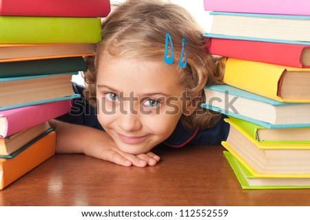 The nice school-girl with the book - stock photo