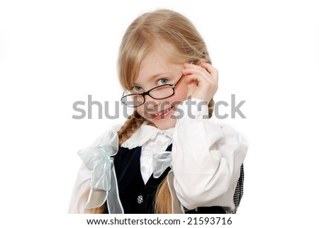 The nice schoolgirl in glasses on a light background. - stock photo