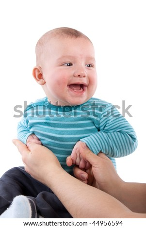 The nice small child in striped rompers on a white background.