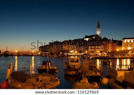 the night in old city Rovinj with boats - Croatia - stock photo