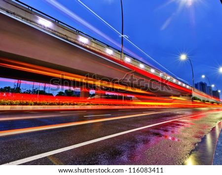 the night of modern bridge, the lights formed a line. - stock photo