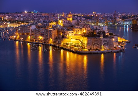 The night view in blue hour of Grand harbor and Senglea peninsula from Valletta, Malta