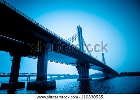the night view of the bridge nanchang jiangxi china. - stock photo