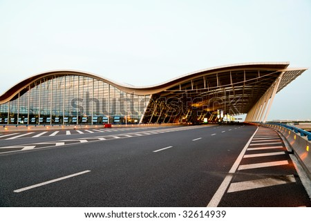 the night view of the pudong airport shanghai china. - stock photo