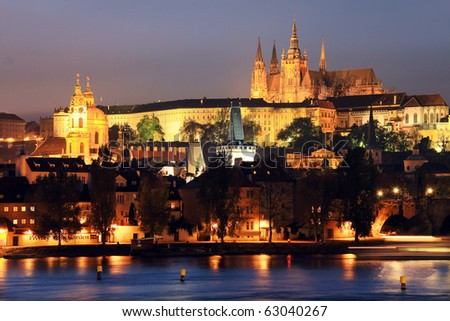 The night View on bright Prague with St. Nicholas' Cathedral and gothic Castle