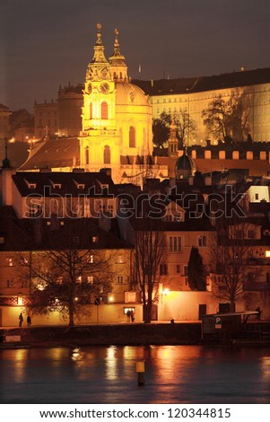 The night View on Prague colorful St. Nicholas' Cathedral, Czech Republic