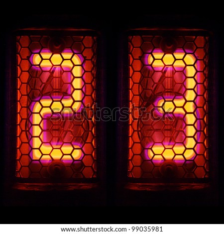 The  Nixie tube indicator of the numbers of retro style. Indicator glow with a magical purple fringing. Digit 2, 3 - stock photo