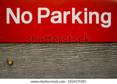 The no parking sign nailed to wooden platform. - stock photo