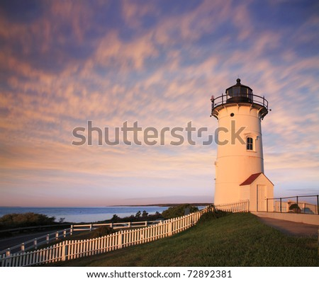The Nobska Point Lighthouse Tower Bathed In Early Morning Sunlight, Woods Hole, Cape Cod, Massachusetts. USA - stock photo