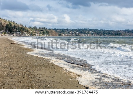 The normally placid Puget Sound is filled with whitewater on a windy day. - stock photo