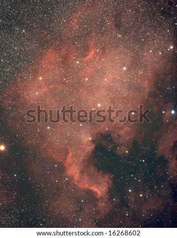 The North America Nebula in the night sky fulfilled with stars - stock photo