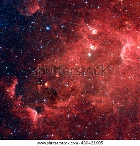 The North America nebula is an emission nebula in the constellation Cygnus, close to Deneb. Infrared view from NASA's Spitzer Space Telescope. Retouched image. Elements of this image furnished by NASA - stock photo