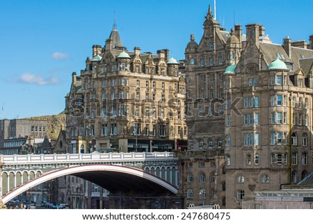 The North Bridge and historic buildings in Edinburgh - stock photo