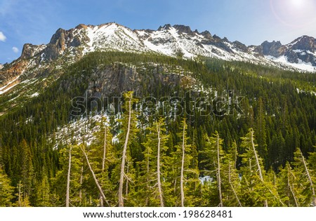 The North Cascade Mountains. Highway 20 in Washington state travels over Washington Pass and Rainy Pass through deep valleys and gorgeous mountain peaks. Also called the North Cascades Highway. - stock photo