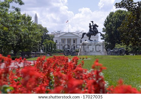 The north facade of the White House seen from Lafayette Park. The equestrian statue of President Andrew Jackson was erected in 1853. The top of the Washington Monument is visible above the trees. - stock photo