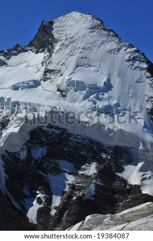 the north face of the Dent d'Herens (4171m)  viewed from the Stockji in the Swiss Alps.