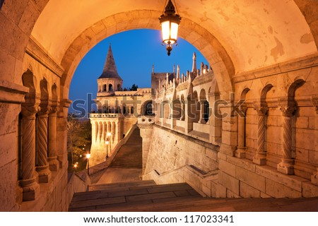 The north gate of the Fisherman's Bastion in Budapest - Hungary at night - stock photo