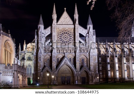 the northern facade of westminster abbey illuminated - stock photo
