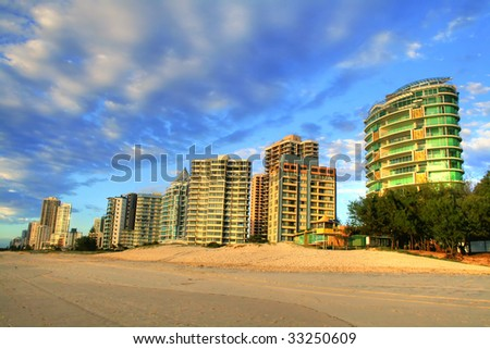 The Northern foreshore of famous Surfers Paradise beach on the Gold Coast Australia after sunrise. - stock photo