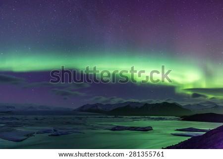 The Northern Light Aurora borealis at Jokulsarlon Glacier Lagoon Iceland - stock photo