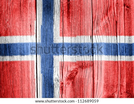 The Norwegian flag painted on wooden fence - stock photo