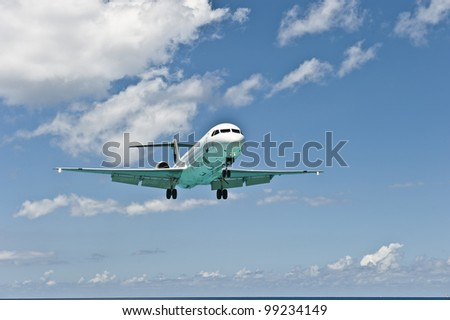 The nose (front) of the airplane flying forward. - stock photo