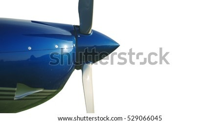 The nose of the aircraft with propeller isolated on a white background