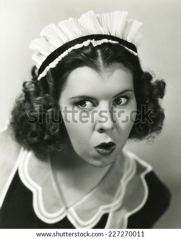 The nosy maid - stock photo