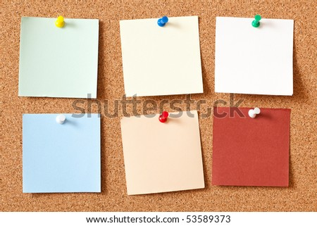 the note papers on corkboard