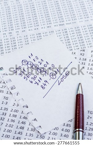 The note with the lose selection of the winning codes on bookmakers - stock photo
