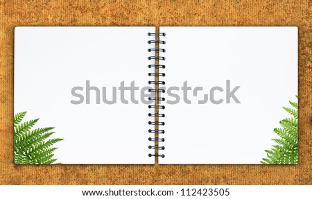 The notebook is on the recycle paper background - stock photo