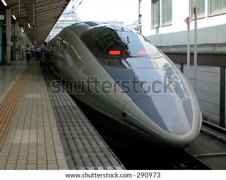 The Nozomi Shinkansen Bullet Train at Tokyo Station - stock photo