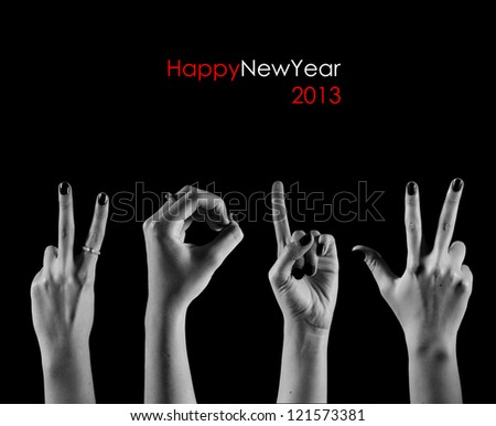 The number 2013 are shown via fingers in creative New Year greeting card