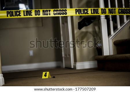 The number 4 crime scene marker on the floor of a house. - stock photo