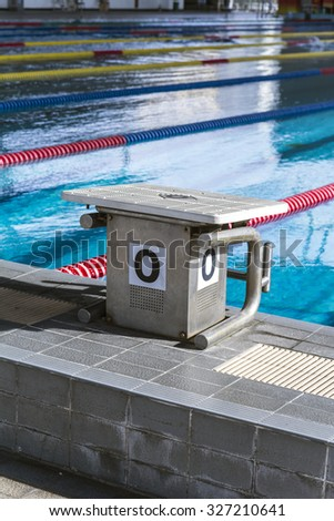 The number 0 diving platform in a swimming pool competition - stock photo