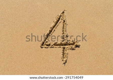 The number 4 drawn on sand at the beach, holiday concept background. - stock photo