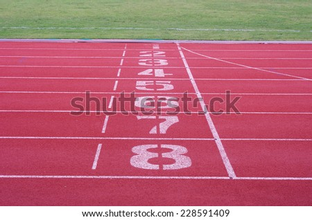 the number on the running lane in the outdoor stadium  - stock photo