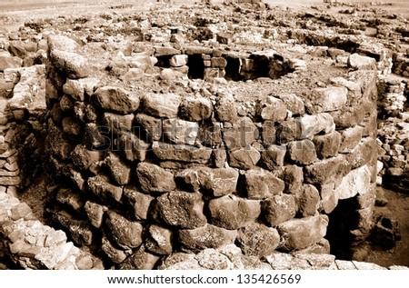 The nuraghe (nuraghi, nuraghes) is ancient megalithic edifice, the symbol of Sardinia and the Nuragic civilization. Sepia - stock photo