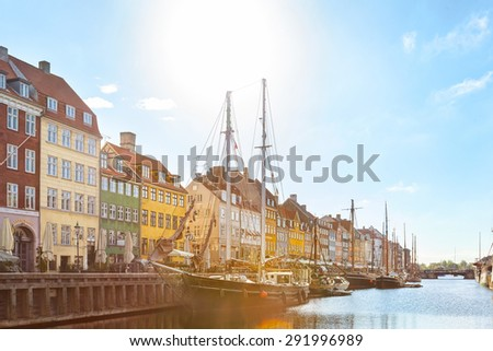 The Nyhavn harbour in a sunny day.COPENHAGEN, DENMARK . - stock photo