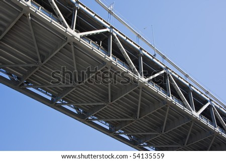 The Oakland Bay Bridge is a complex of toll bridges in the San Francisco Bay Area of California, in the United States. - stock photo