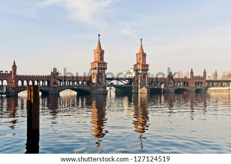 The Oberbaumbrucke bridge connects the districts of Kreuzberg and Friedrichshain over the river Spree at Berlin, Germany - stock photo