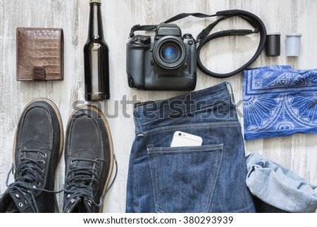 The objects of a film photographer on the white wooden background - stock photo