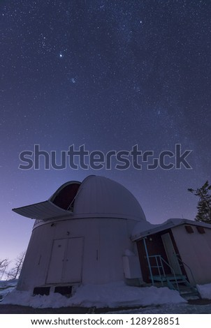 The observatory containing the 60 inch telescope sits on top of Mount Lemmon in Arizona, searching for near Earth asteroids.  The winter Milky Way stretches overhead, along with bright Jupiter.